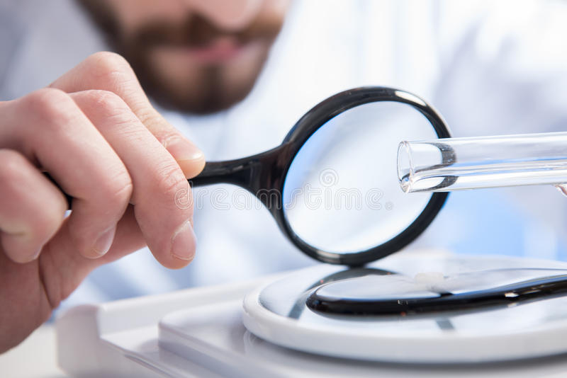 Sample throungh magnifying glass stock photo