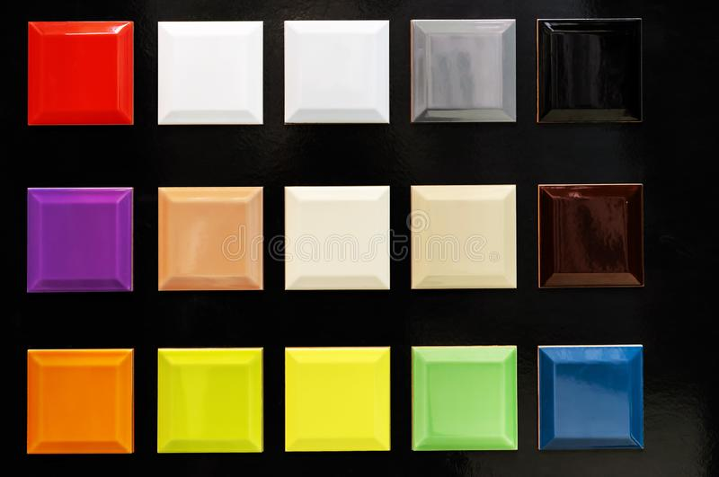 Samples of ceramic tiles of different colors on a black background royalty free stock photo