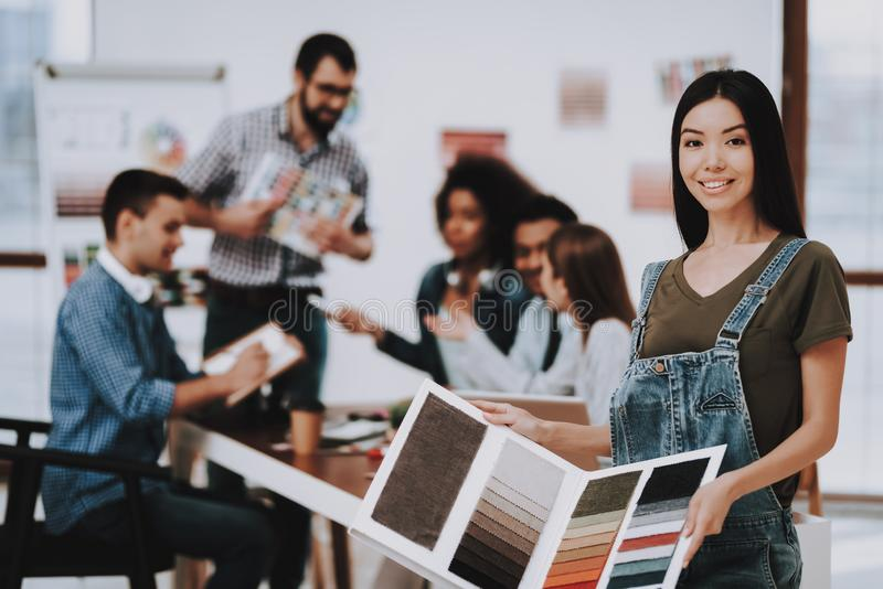 Samples of Color. Asian Girl. Office. Designers. stock photos