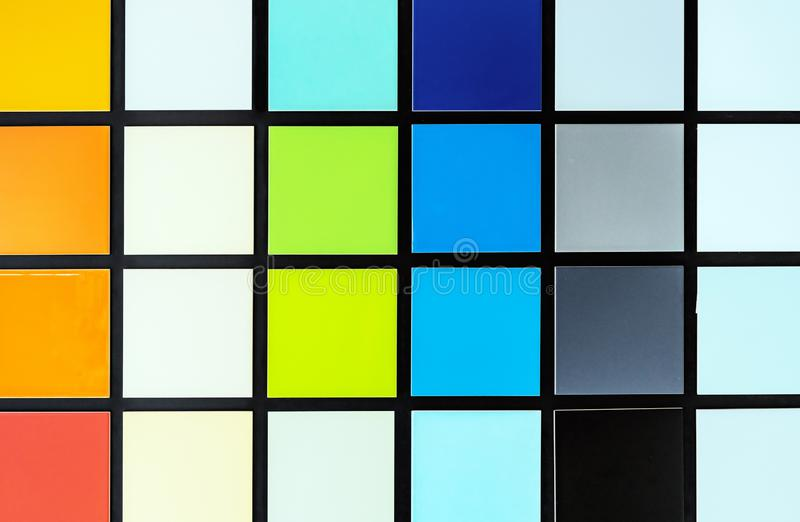 Samples of colored ceramic tiles. Palette of square tiles royalty free stock photography