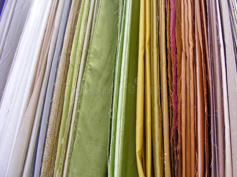 Samples of colorful fabric in shop / Different Multi colored fabrics stock photos