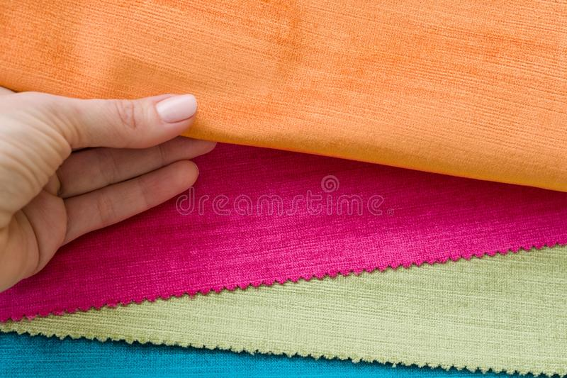 Samples of colorful interior fabrics. Book of fabrics for curtains, upholstery royalty free stock photography
