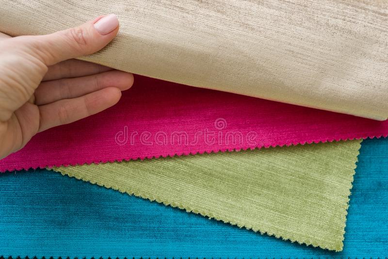 Samples of colorful interior fabrics. Book of fabrics for curtains, upholstery royalty free stock image