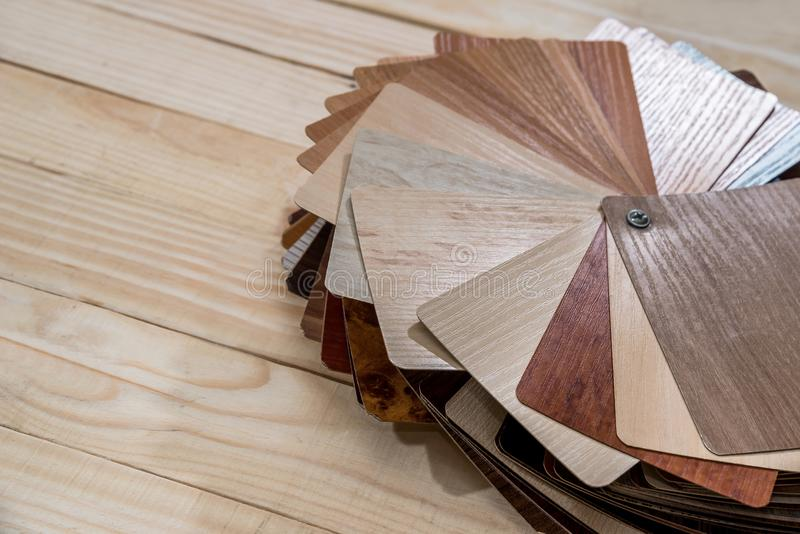 Samples of laminate wooden planks. For furniture decor royalty free stock image