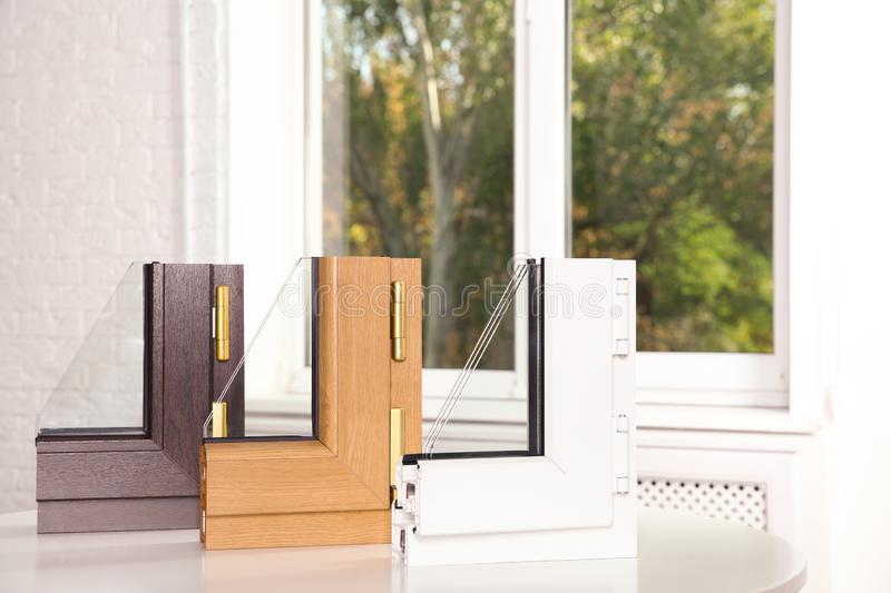 Samples of modern window profiles on table indoors. Installation service stock photo