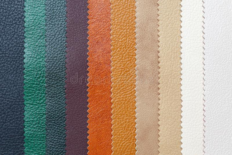Samples of natural, textured, multi-colored leather. Top view stock photography