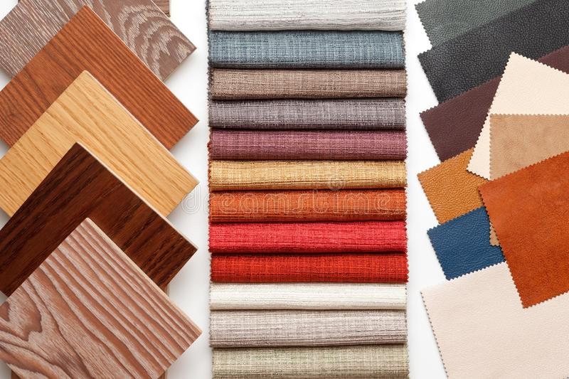 Samples of parquet, fabric for curtains, and leather for the work of the interior designer royalty free stock images
