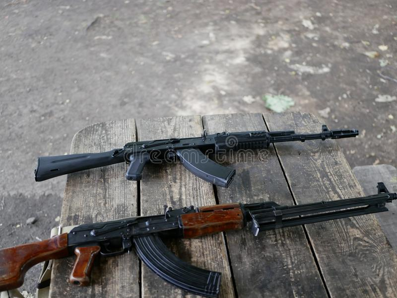 Samples of Soviet automatic weapons of the second world war. Machine guns and machine guns on a wooden table outside on a summer d. Ay stock image