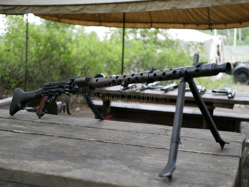 Samples of Soviet automatic weapons of the second world war. Machine guns and machine guns on a wooden table outside on a summer d. Ay royalty free stock image