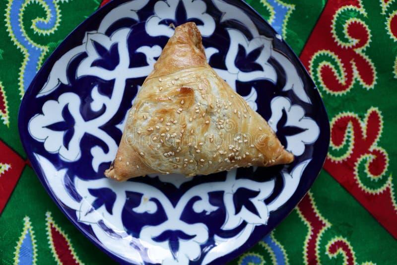 Samsa on a plate. In the uzbek restaurant stock photo