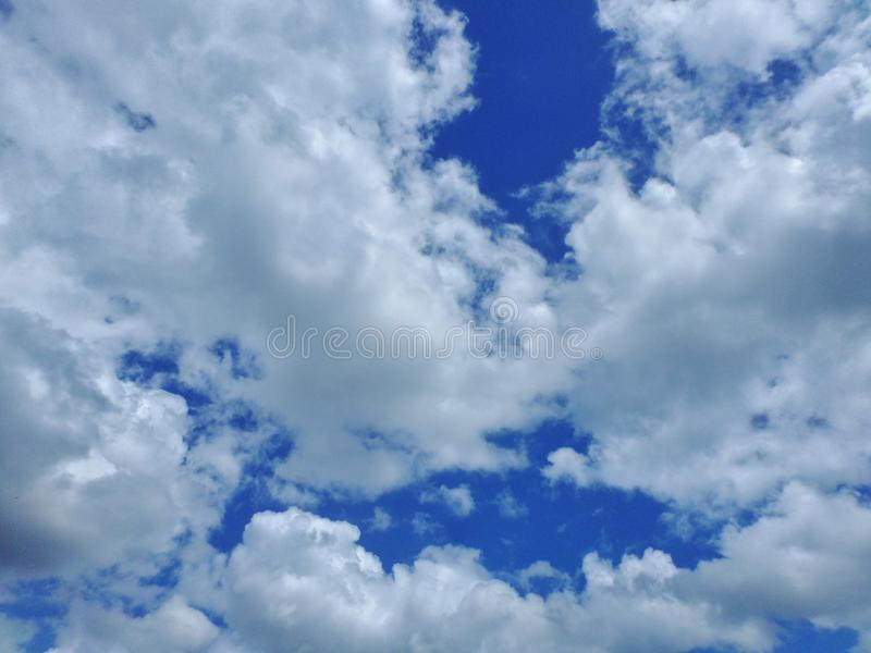White and grey clouds on a Blue sky royalty free stock photos