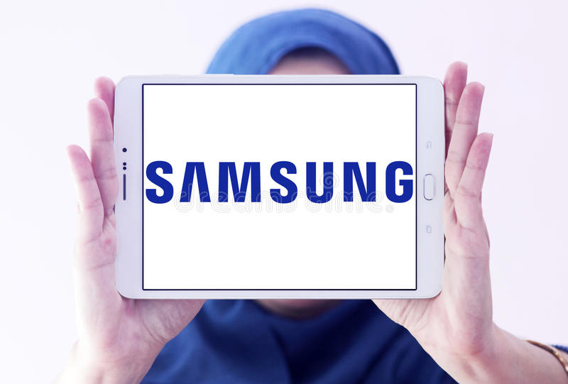 Samsung company logo. Logo of electronics company samsung on samsung tablet holded by arab muslim woman stock photography