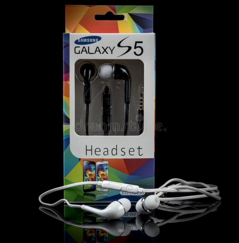 Samsung Galaxy headset on black background royalty free stock images