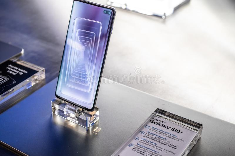 Samsung Galaxy S10+ plus smartphone, presentation features of Samsung S10+ with Android at Samsung exhibition pavilion showroom. Nadarzyn, Poland, May 11, 2019 royalty free stock image