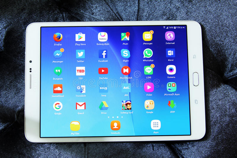 Social media network applications icons. Shot of samsung new tablet tab s2 with 8 inch touchscreen displaying touchscreen applications such as Google maps royalty free stock images