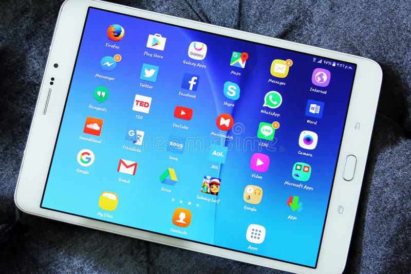 Social media network applications icons. Shot of samsung new tablet tab s2 with 8 inch touchscreen displaying touchscreen applications such as Google maps stock image