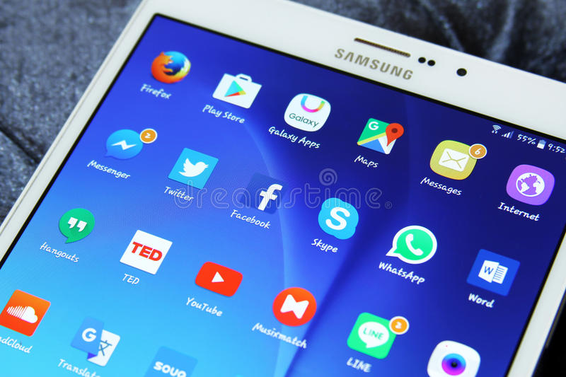 Social media applications icons. Shot of samsung new tablet tab s2 with 8 inch touchscreen displaying touchscreen applications such as Google maps, Facebook royalty free stock image