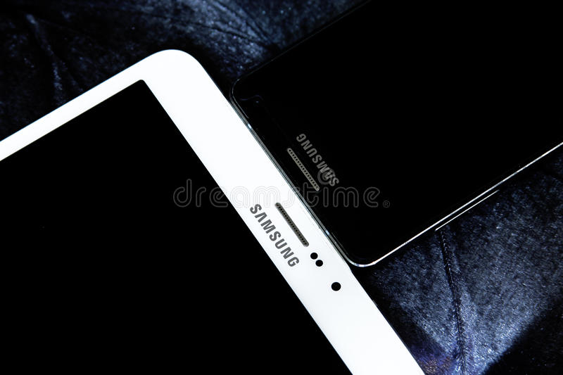 Samsung tablet and mobile. Tablet samsung galaxy tab s2 with samsung smart phone a5 royalty free stock image