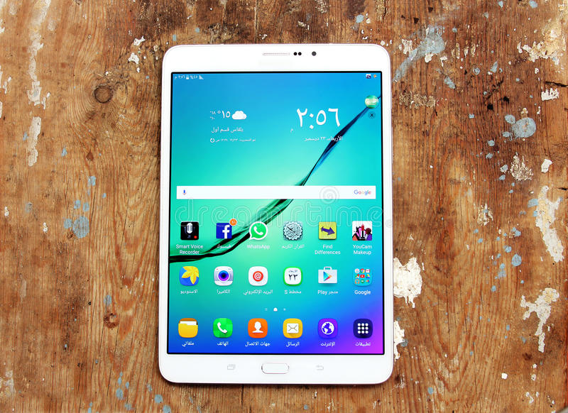 Samsung tablet with social media. Shot of samsung new tablet tab s2 with 8 inch touchscreen displaying touchscreen applications for social media such as Google royalty free stock photo