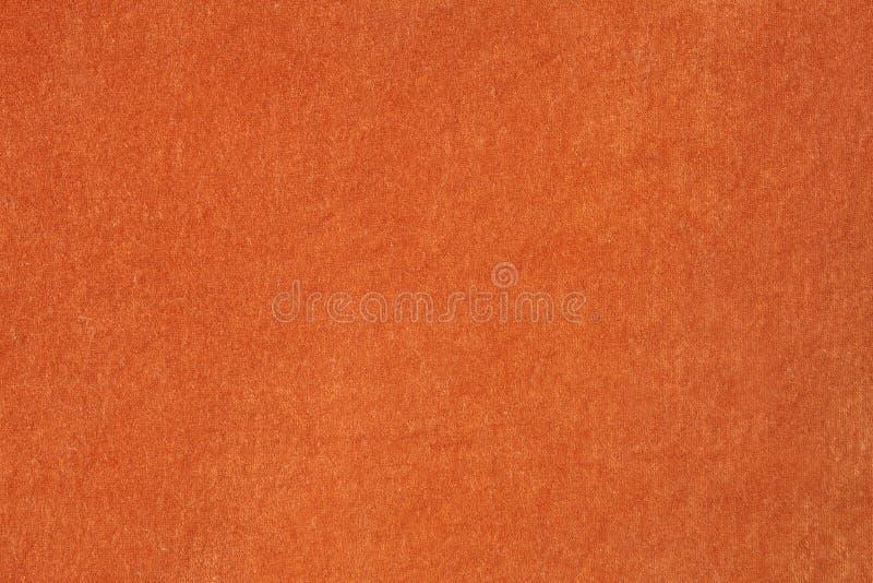 Samt u. orange Luxusstoff stockfoto