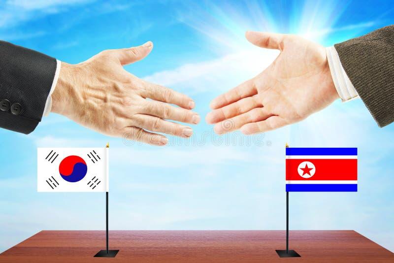 Samtal mellan norden och Sydkorea royaltyfri bild