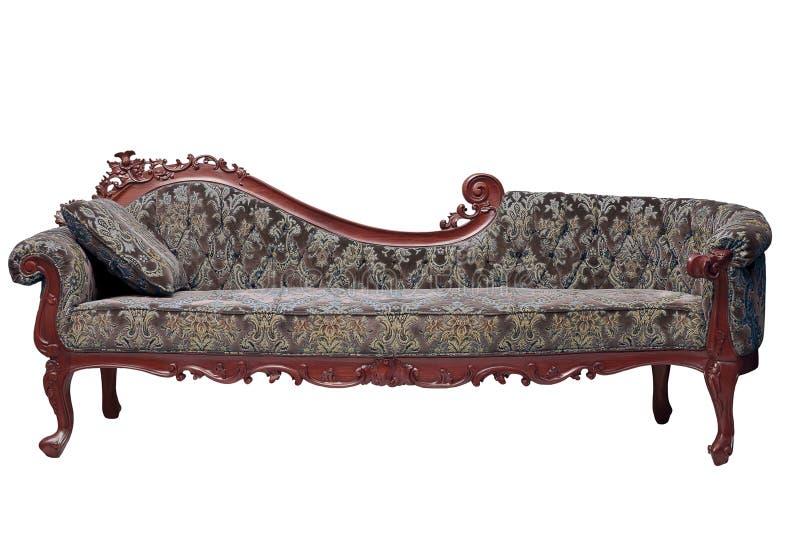 Samtida stil för klassisk sofa i tappninglokal arkivfoto