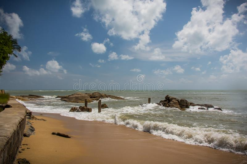 Samui beach view. Beautiful Samui beach with gold sand and brown rocks stock photos