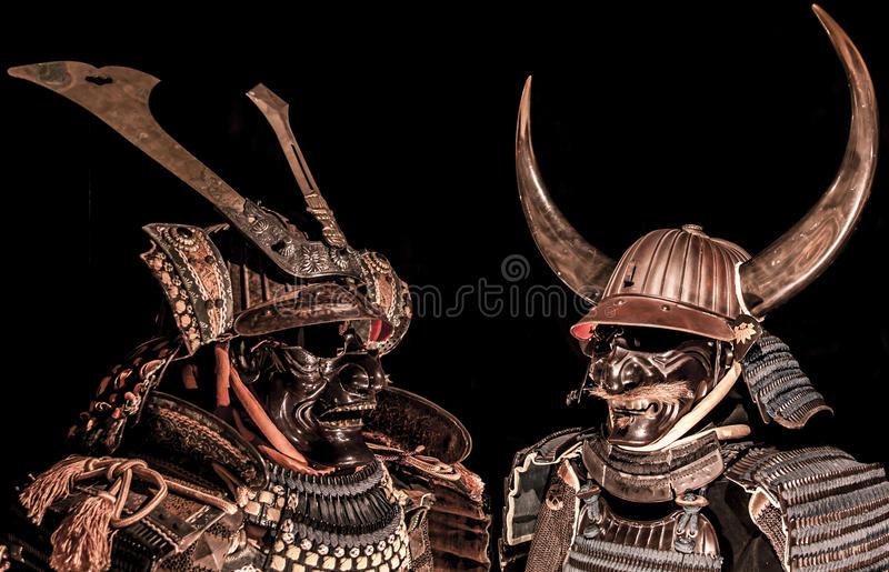 Samurai body armor. Two samurai body armor isolated on black background royalty free stock photos
