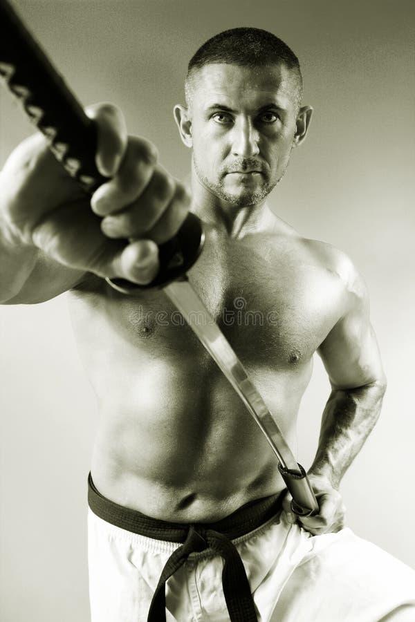 Samurai com uma espada fotografia de stock