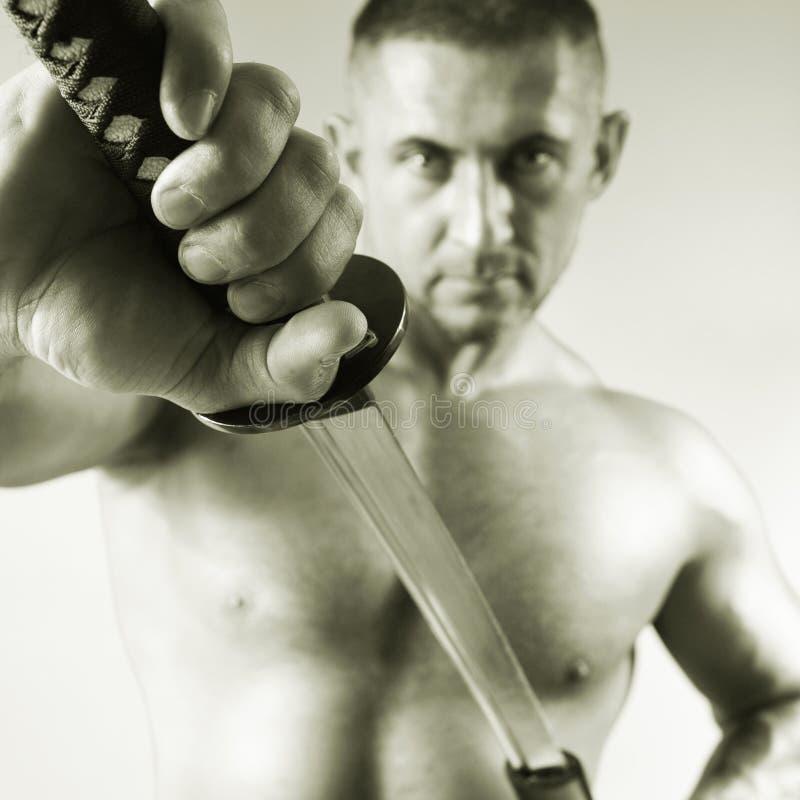 Samurai com uma espada fotos de stock royalty free