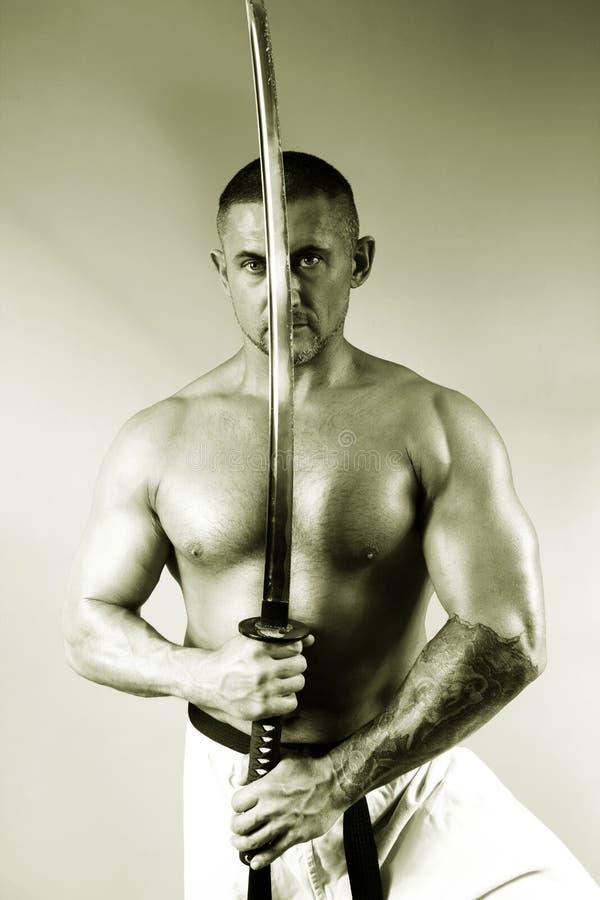 Samurai con una espada fotos de archivo libres de regalías