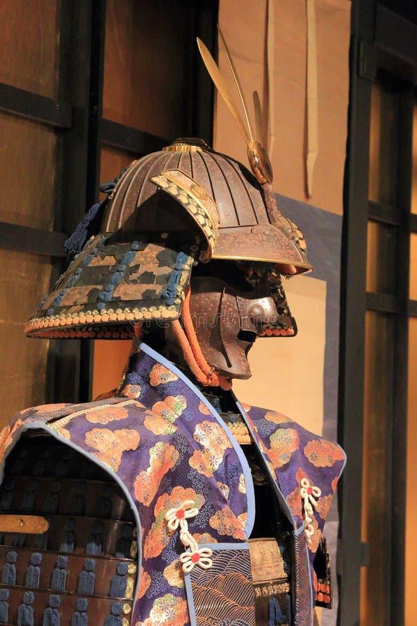 Samurai en jinbaori foto de archivo