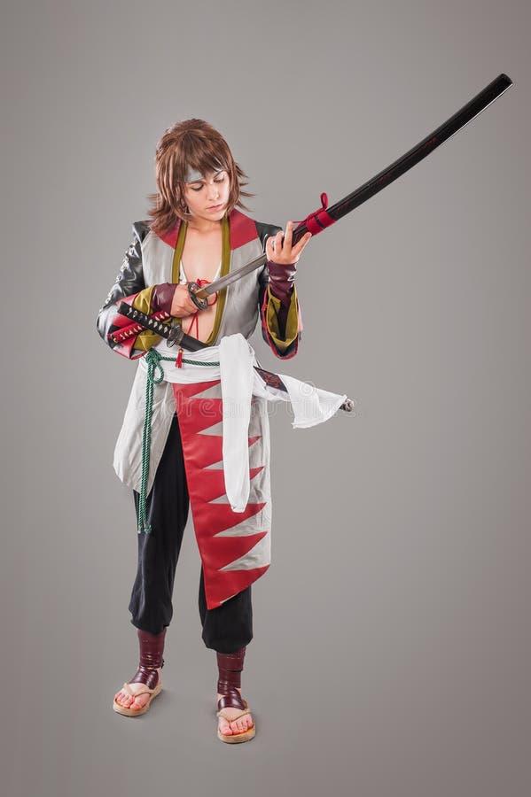 Samurai giapponese con la spada di katana immagine stock