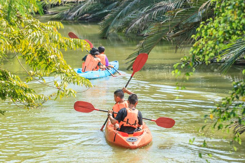 Young students learning in kayaking in canal. royalty free stock photo