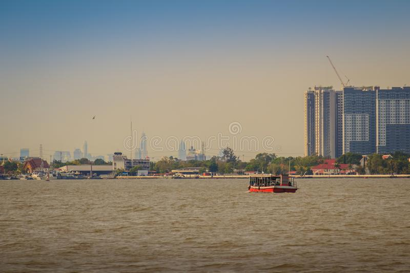 Samut Prakan, Thailand - March 25, 2017: The public ferry service during across Choa Phraya River. Samut Prakan is at the mouth o. F the Chao Phraya River on the stock photography