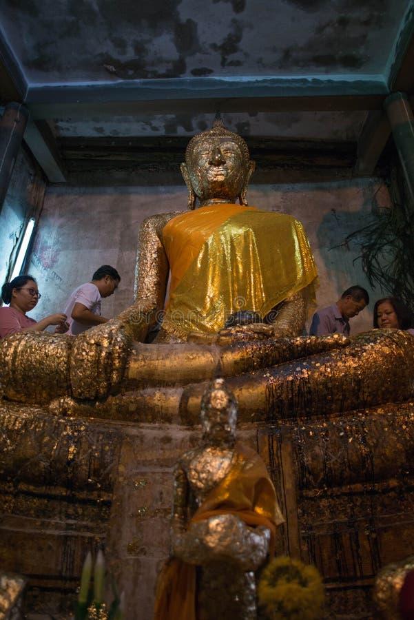 Samut Songkhram,Thailand - June 11 , 2016: People in thai temple. For editorial use only. Samut Songkhram,Thailand - June 11 , 2016:A lot of people in thai royalty free stock photo