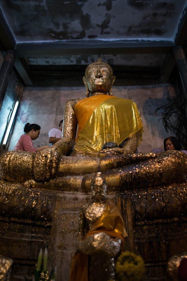 Samut Songkhram,Thailand - June 11 , 2016: People in thai temple. For editorial use only. Samut Songkhram,Thailand - June 11 , 2016: People in thai temple. For stock photos