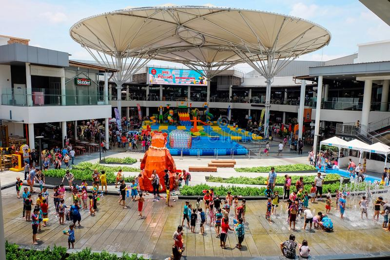 Samutprakarn, Thailand - April 13 2019: Many people is play or splashing water in Songkran Festival at Megabangna Shoppingcenter. The most popular place to stock photography