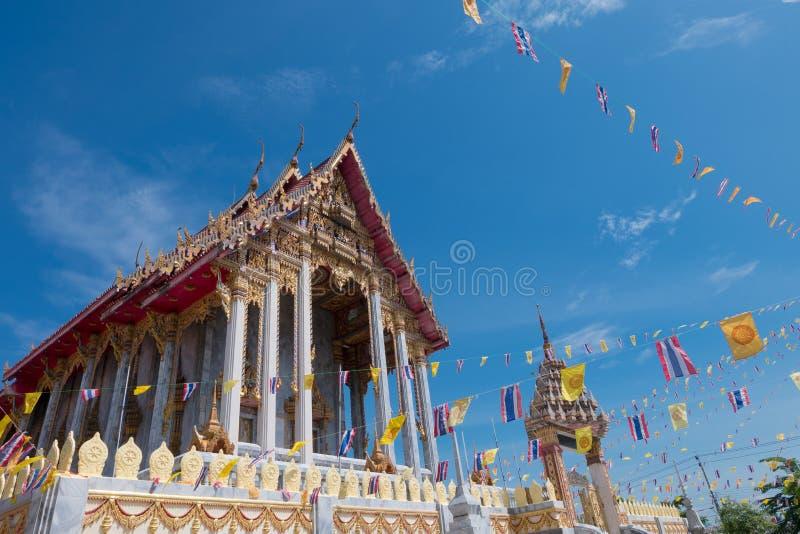 Samutprakarn, Thailand - July 19: Thai Buddhist decorate temple with Thailand flag and yellow Buddhism symbol flag to celebrating royalty free stock image