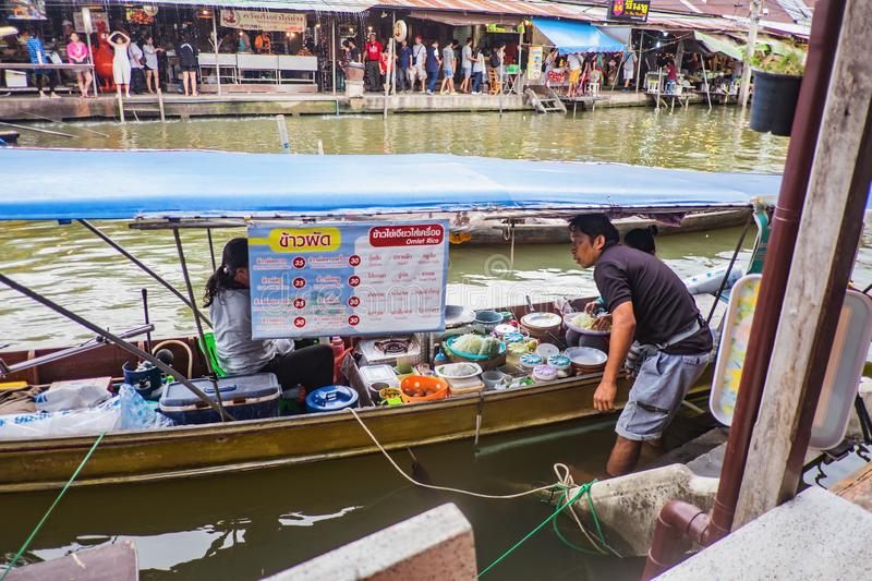 Unacquainted Thai people Selling local Food on the boat in  Amphawa Floating market in holiday time. Samutsongkhram/Thailand - 16 September 2017 : Unacquainted stock images