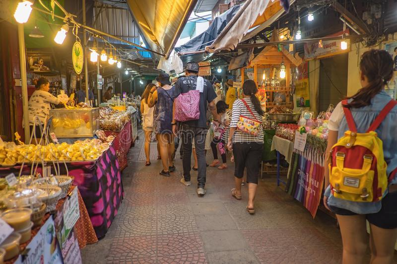 Unacquainted Thai people and tourists come to visit Amphawa Floating market in holiday time. Samutsongkhram/Thailand - 16 September 2107 : Unacquainted Thai royalty free stock image