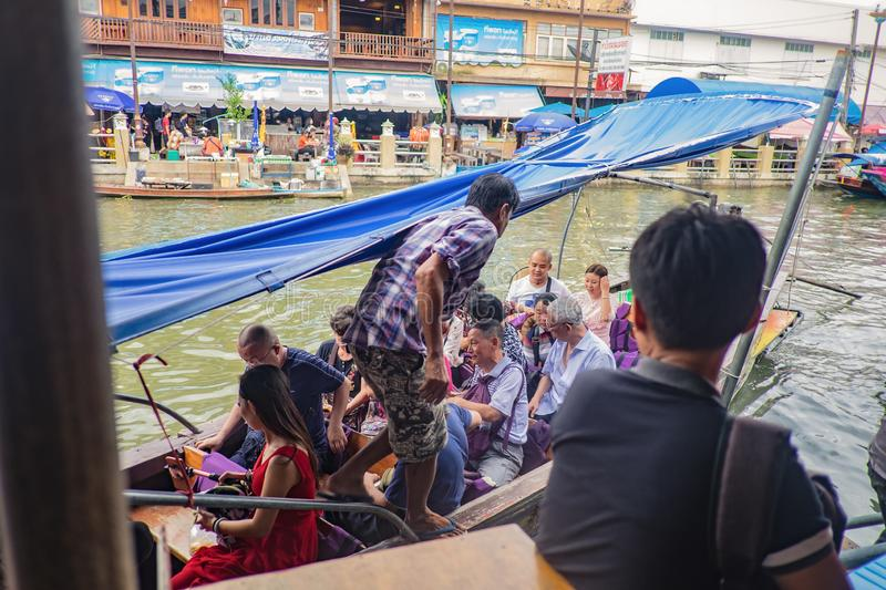 Unacquainted Thai people and tourists come to visit Amphawa Floating market in holiday time. Samutsongkhram/Thailand - 16 September 2017 : Unacquainted Thai royalty free stock images