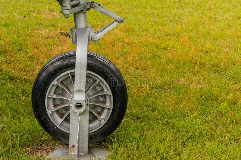 Samyang tire on nose gear. Daejeon, South Korea; October 3, 2019: Samyang tire mounted on front landing gear with of Lockheed T-33 jet trainer on display at stock photography