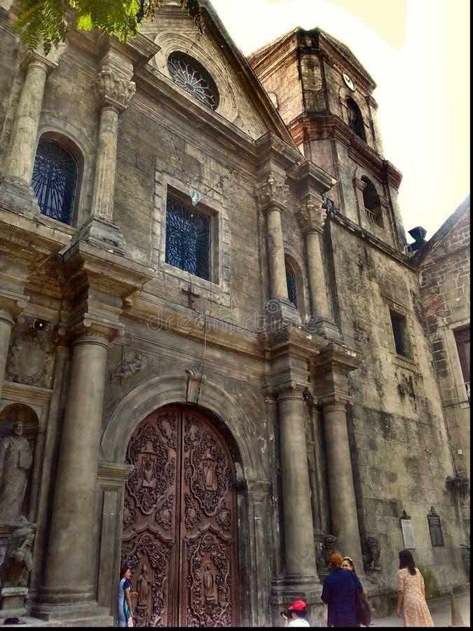 San Agustine kyrka, en annan acient arkitektonisk byggnad inom den walled staden av royaltyfri foto
