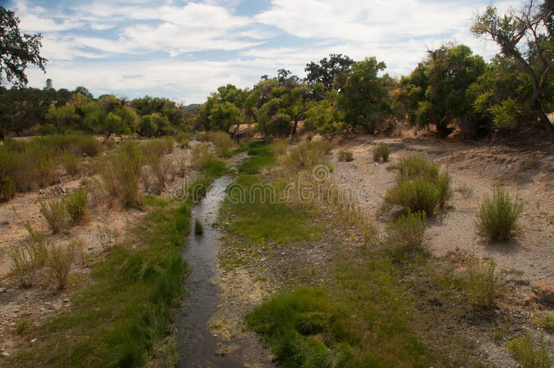 San Andreas Fault creekbed. This creek bed is usually dry. It is the exact fault line of the San Andreas Fault in Parkfield, CA. This image is landscape stock photo