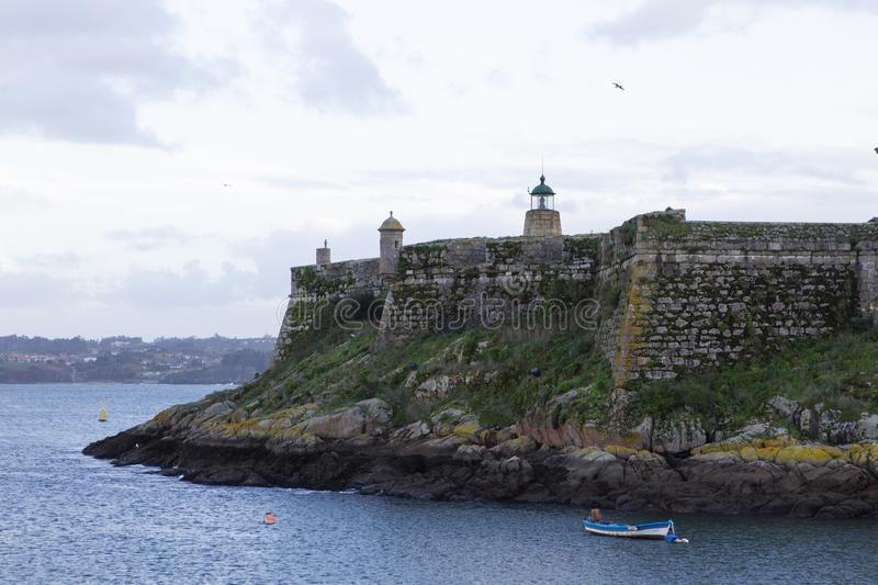 San Anton Castle in La Coruna, Spain. Surrounded by sea stock photos