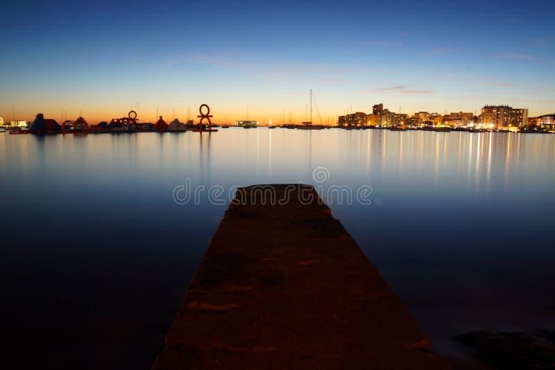 San Antonio Bay in Ibiza, Spain by Twilight stock image