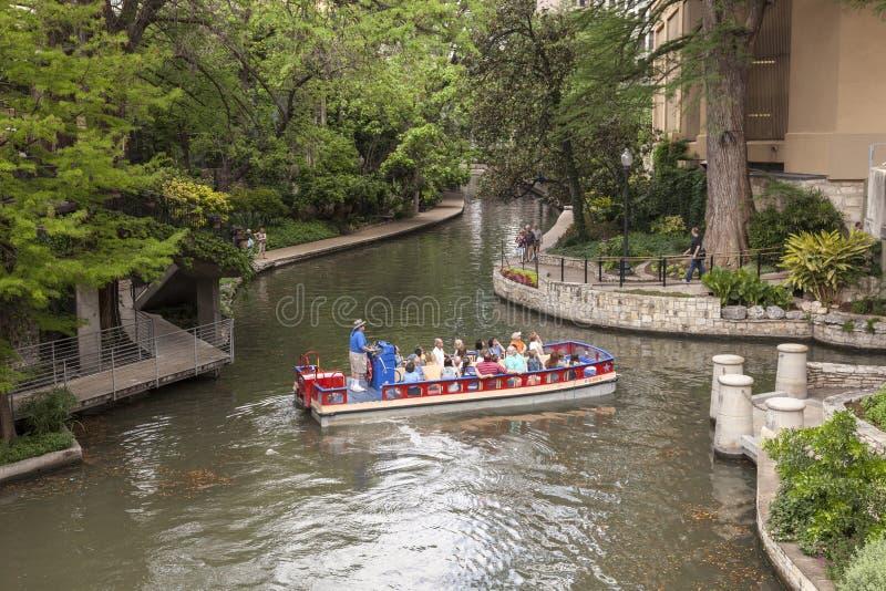 San Antonio River Walk, Texas. SAN ANTONIO, USA - APR 11: Sightseeing boat at the famous San Antonio River Walk. April 11, 2016 in San Antonio, Texas, United royalty free stock photo