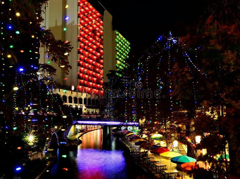 San Antonio Riverwalk at night. The San Antonio Riverwalk at night with bright Christmas lights and ambient lighting royalty free stock images