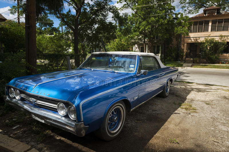 Classic blue car parked in a suburban area of the city of San Antonio, Texas, USA. stock photography